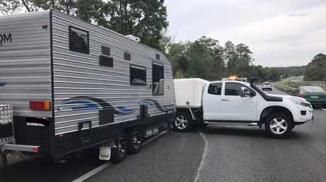 A 4WD and caravan blocking the Bruce Hwy near Nambour.