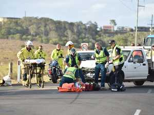 Paramedics on scene of motorcycle v ute accident