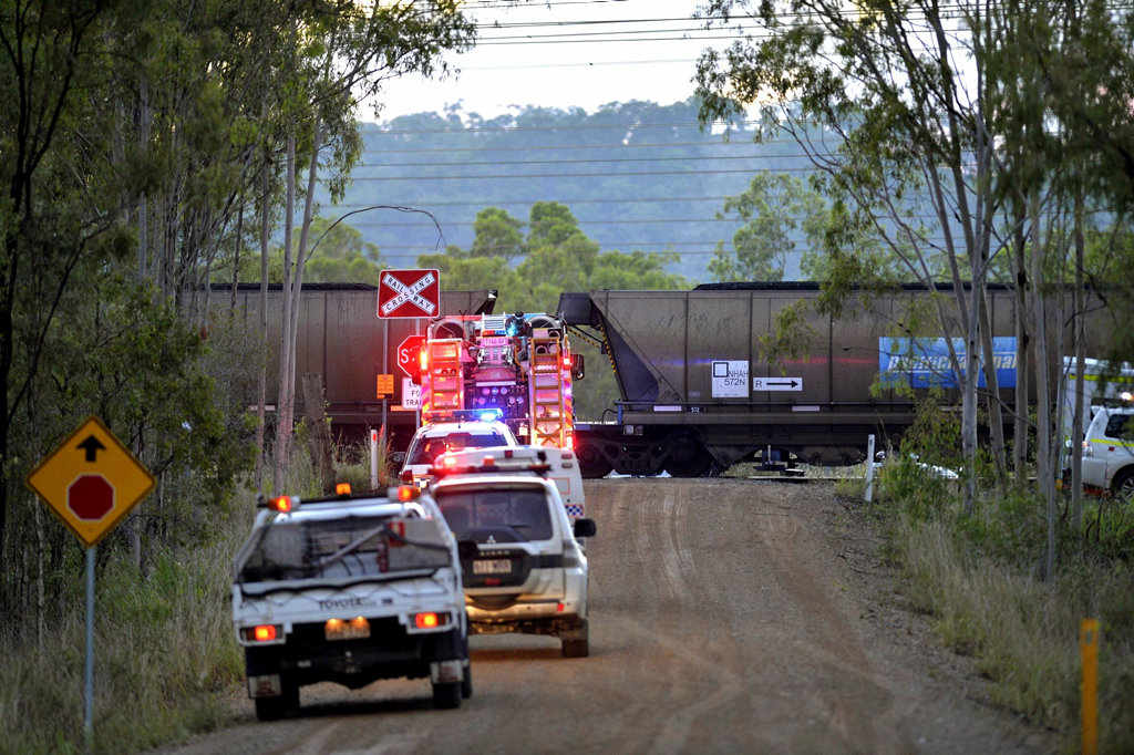 Emergency crews gain access to a car which has been hit by a coal train off Red Rover Rd.