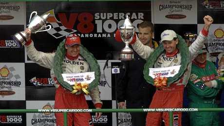 WINNERS: Holden Racing Team drivers Mark Skaife (L) and Tony Longhurst (R) celebrate on the podium after winning the 2001 V8 Supercar Bathurst 1000.