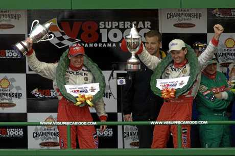 WINNERS: Holden Racing Team drivers Mark Skaife (L) and Tony Longhurst (R) celebrate on the podium after winning the 2001 V8 Supercar Bathurst 1000.