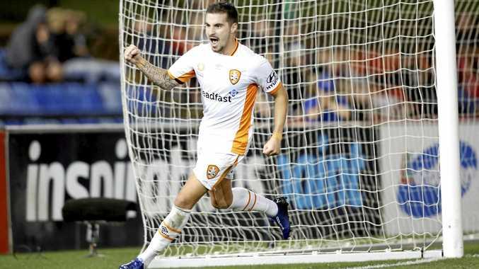 Jamie Maclaren of Brisbane Roar celebrates scoring against the Newcastle Jets on Sunday