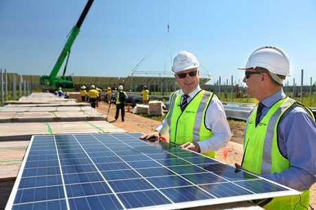 Sunshine Coast Council Mayor Mark Jamieson and Cr Steve Robinson were on hand when the first solar panels were lifted into place at the Sunshine Coast Solar Farm, Valdora.