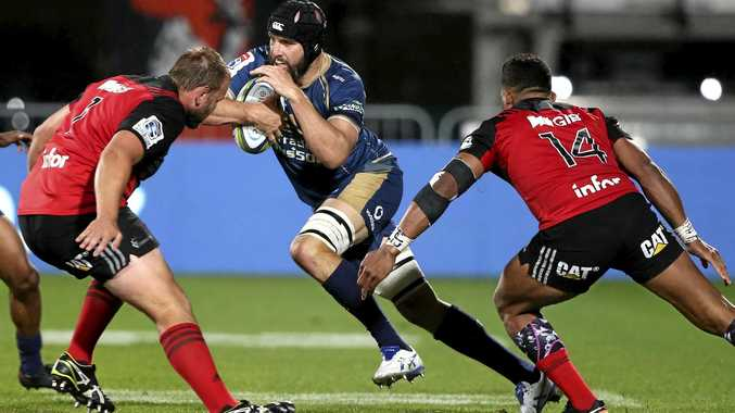 The Brumbies' Scott Fardy makes a run at Crusaders Joe Moody (left) and Seta Tamanivalu.