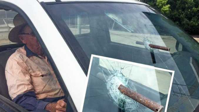 A driver had a close call after his windscreen was pierced by a heavy metal bar on the Bruce Hwy.