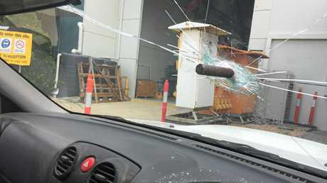 The bar can be seen lodged in the driver's side windscreen.