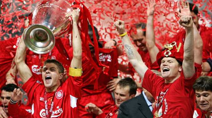 Liverpool captain Steven Gerrard (left) holds the trophy after Liverpool's victory in the the 2005 UEFA Champions League final.