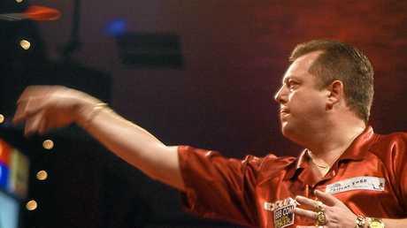 England's Mervyn King throws a dart.