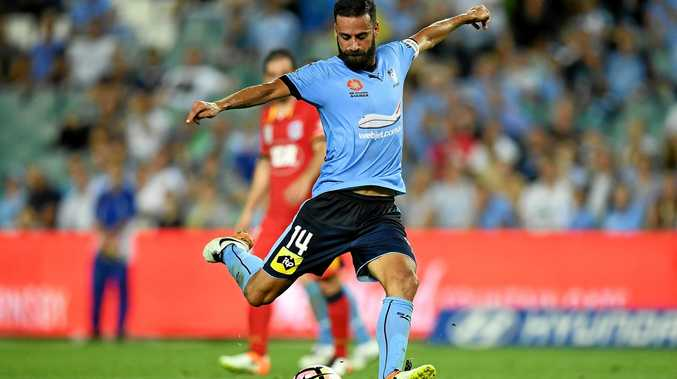 Alex Brosque of Sydney FC takes a shot at goal.