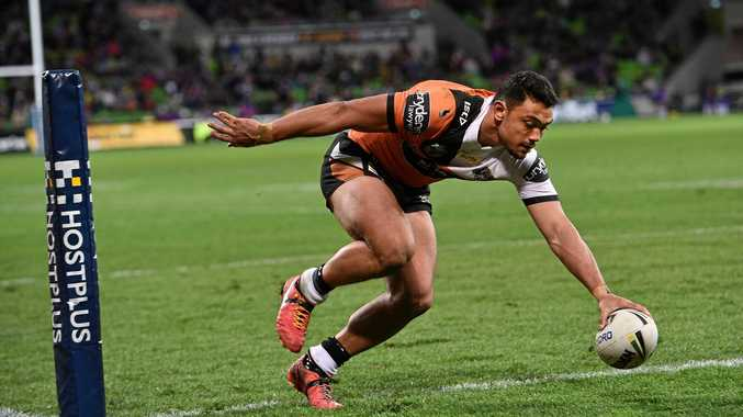 Tim Simona scores a try for the Tigers last year.