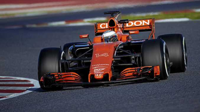 Fernando Alonso puts his McLaren through its paces in Barcelona.