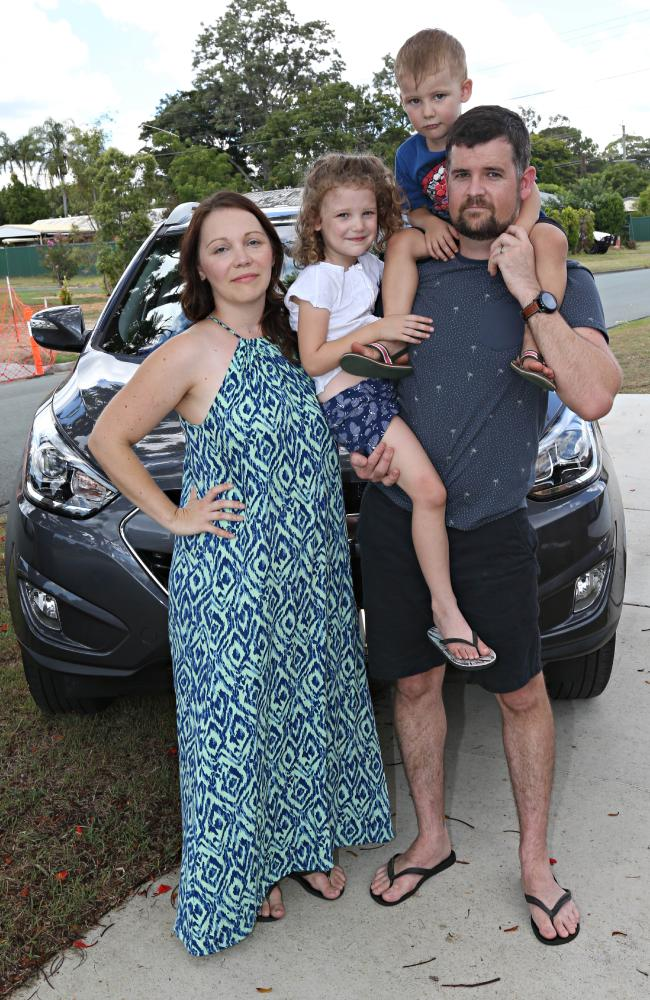 Bad and Cassandra Aldcroft with their kids Owen, 3, and Emma, 5, with their troublesome Hyundai. Picture: Annette Dew