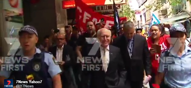 John Howard was forced to use a police escort after stumbling upon a union protest in Sydney this morning.