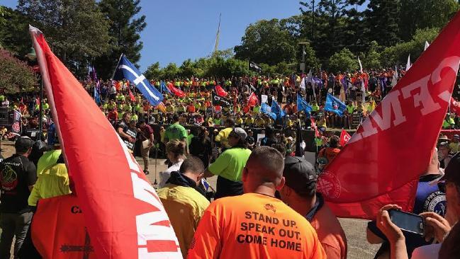 Union members walk off the job in Brisbane.