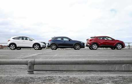 Three-car comparison between Honda HR-V, Mazda CX-3 and Toyota C-HR.
