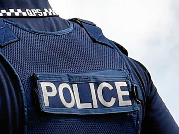 A man who allegedly threatened a couple with an iron bar at their Millbank home has been charged by Bundaberg police.