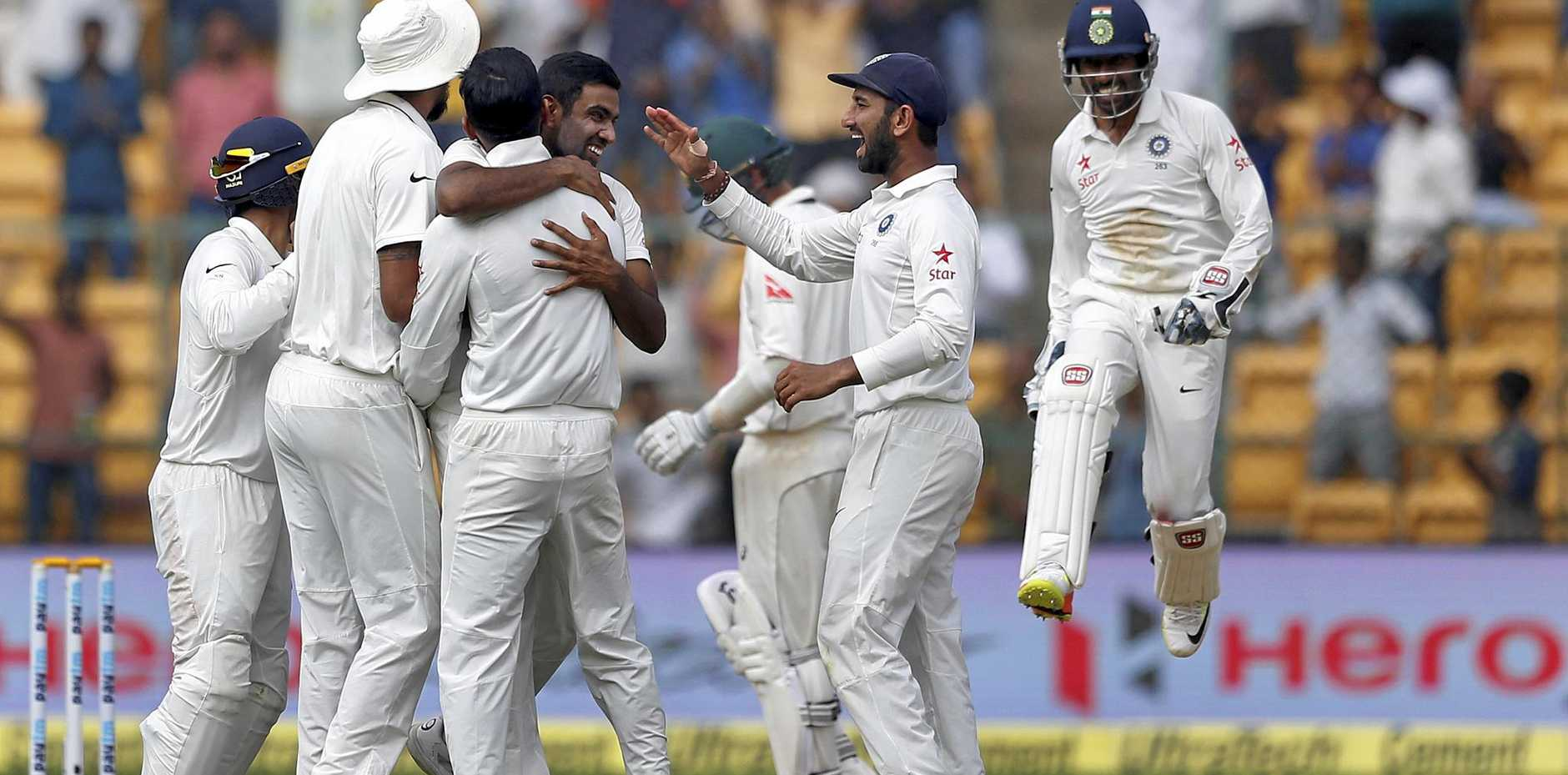 India celebrates the dismissal of Australia's Peter Handscomb during the fourth day of the second Test.
