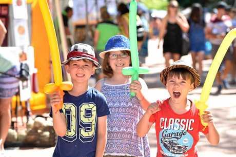 Urangan Pier Park Community Markets - (L) Marcos,6, Ella,7, and Ashley,4, Woods enjoying a visit to the market.