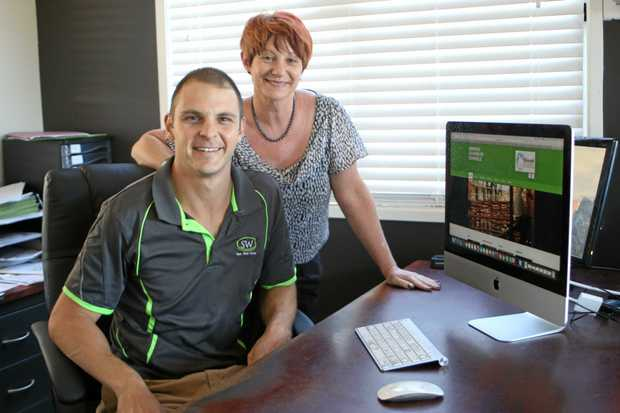 BACK IN BUSINESS: Warwick Chamber of Commerce vice-president David Martin and president Julia Keogh unveil the new website that promises to deliver up-to-date information for business members.