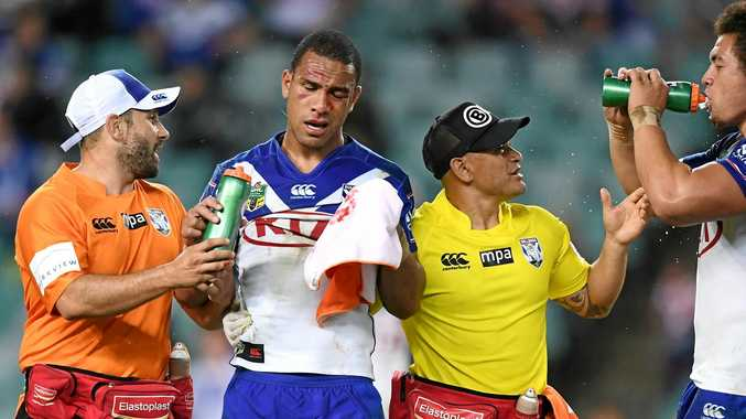 Will Hopoate of the Bulldogs is assisted from the field.