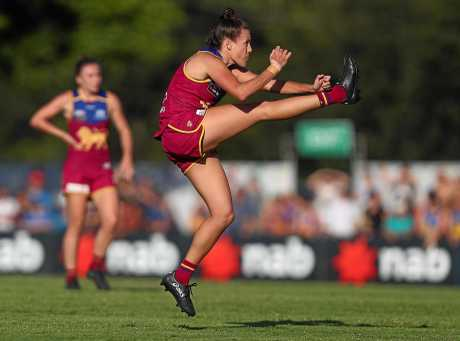 Emma Zielke of the Lions kicks during the AFLW round-three match against the Collingwood Magpies at South Pine Sports Complex.