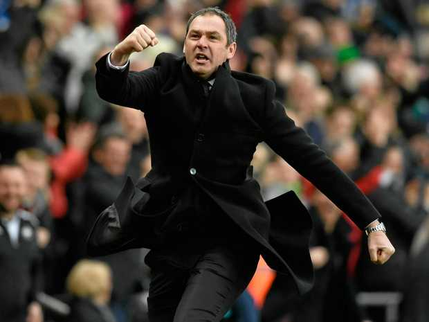 Swansea manager Paul Clement celebrates his side's winner against Burnley.