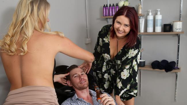 Shane Gelling gets a topless head massage at Studio 78 in Cairns as he tries out the Frisky Friday with owner Emma Gelling
