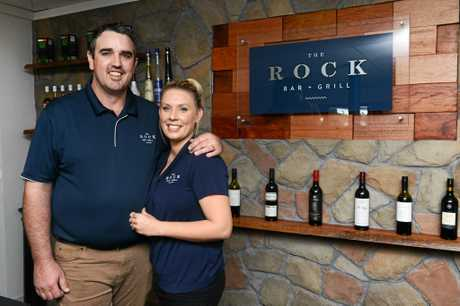 A photo of owners Steve and Courtney Evans at the Rock Bar and Grill.