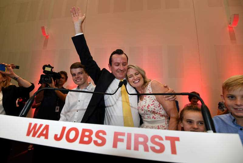 Premier-elect West Australian Labor leader Mark McGowan his wife Sarah and their children acknowledge supporters at the party's election night event in Perth