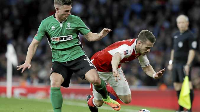 Arsenal's Aaron Ramsey, right, competes for the ball with Lincoln City's Jack Muldoon in the FA Cup quarter-final.