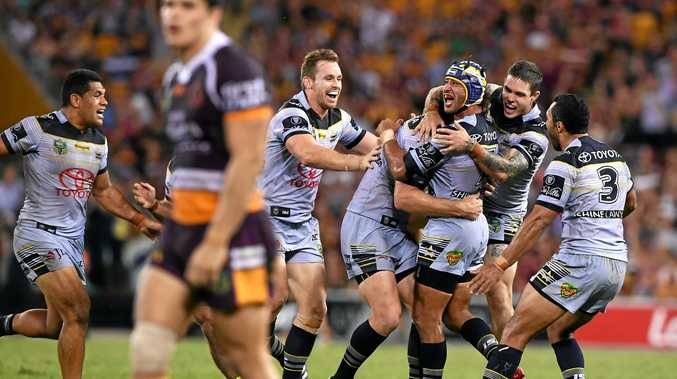 Cowboys skipper Johnathan Thurston is swamped by teammates after kicking a field goal to down the Brisbane Broncos in extra time on Friday night.