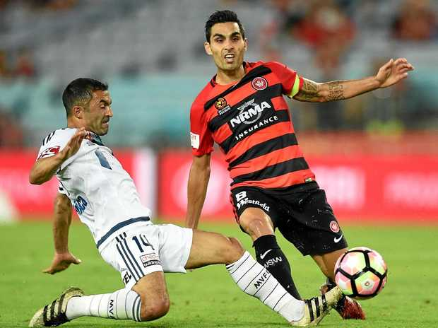 Dimas Delgado of the Wanderers (right) is happy at the club and wants to stay.