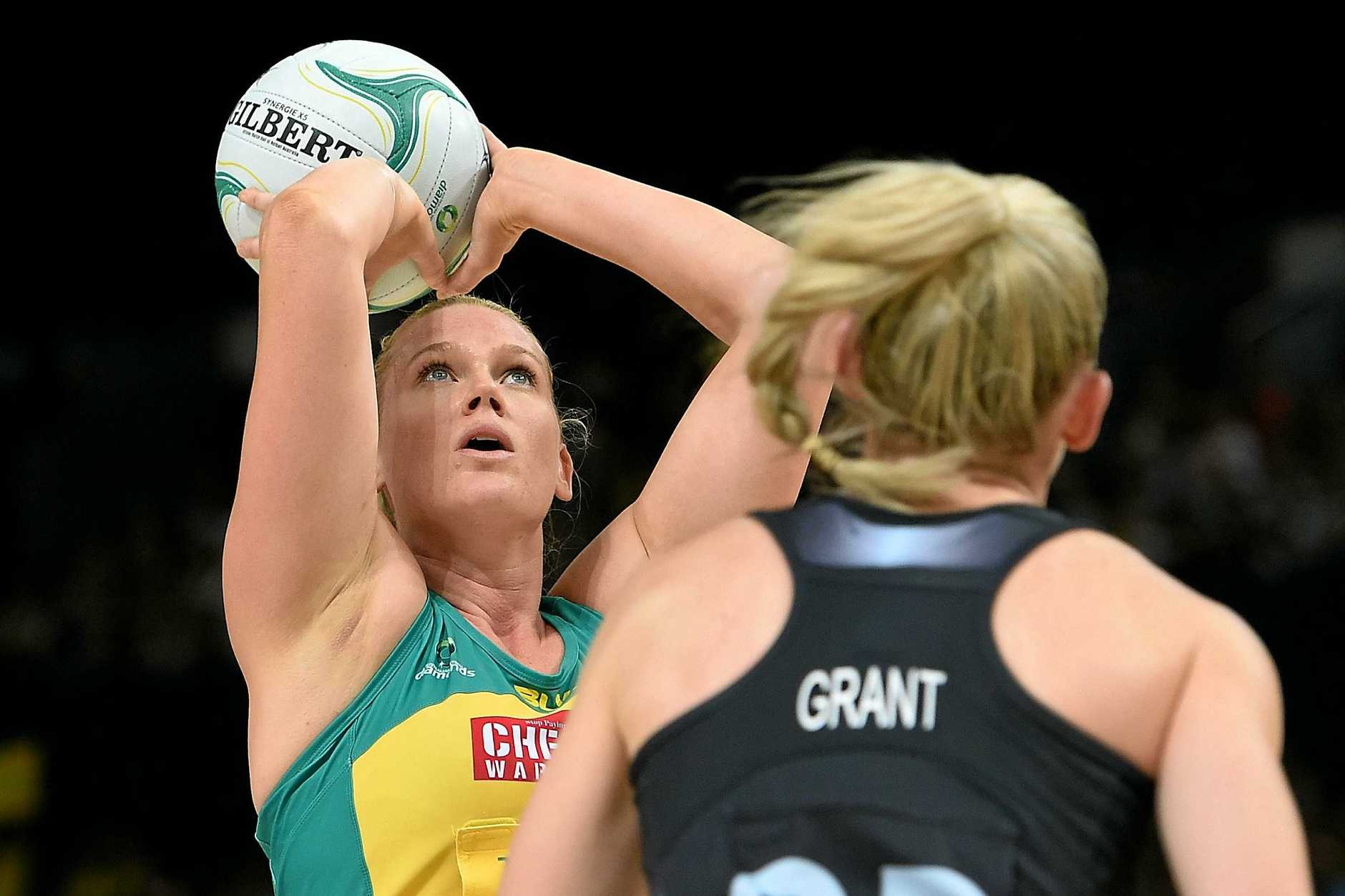 Magpies star Caitlin Thwaites lines up a shot while playing for Australia.