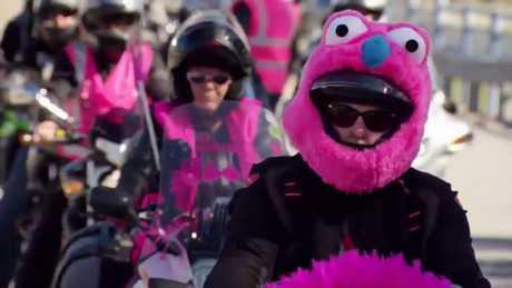 A giant pink head-eating puppet helmet?