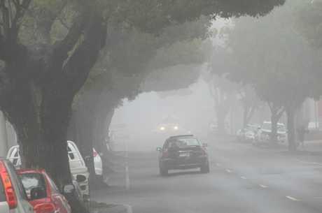 Fog shrouds Toowoomba streets.