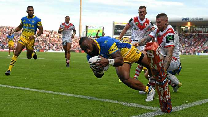Semi Radradra of the Eels scores one of his four tries against the Dragons.