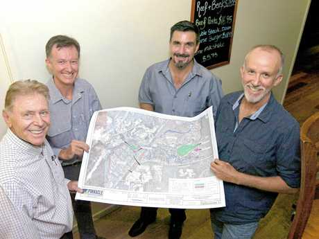 Graham Marsh, Jonathan Mann, Jason Sullivan and Michael Mann with plans for the Station Creek Lifestyle RV Home Park and Resort.