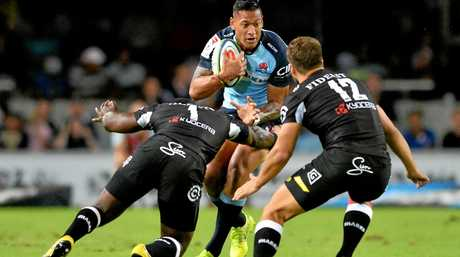 Israel Folau of the Waratahs is tackled by Tendai Mtawarira and Andre Esterhuizen of the Sharks