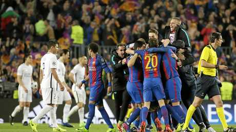 Barcelona players celebrate at the end of the Champions League round-of-16, second leg soccer match