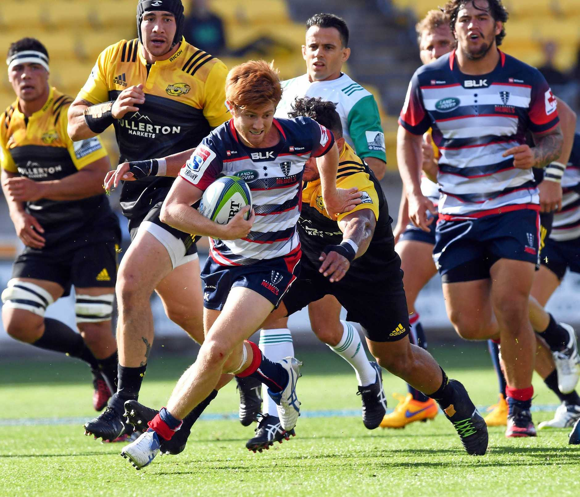 Nic Stirzaker of the Rebels makes a break against the Hurricanes