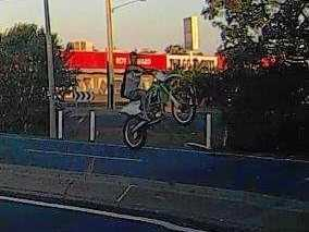 Rider who popped wheelie wanted by police