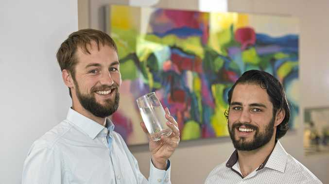 HERE TO HELP: Michael Osborne (left) shows the importance of keeping hydrated with James MacKay of HealthGuard Wellness. The chiropractors regularly hold healthly living information evenings.