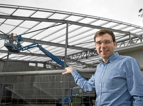 GOING UP: Reverend Adam Lowe is excited to watch the progress of St Bart's Anglican Church extension.