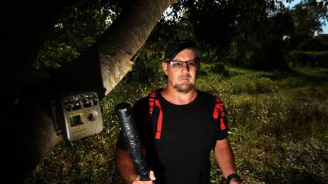 Jason Heal, a yowie hunter with all the essentials for successful yowie hunting: head cam, tree cam, hand cam and rubber tree thumper.