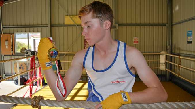 GOLDEN GLOVES: Boxer Jesse Jenner with the medal he won at the Queensland Selection Trials.