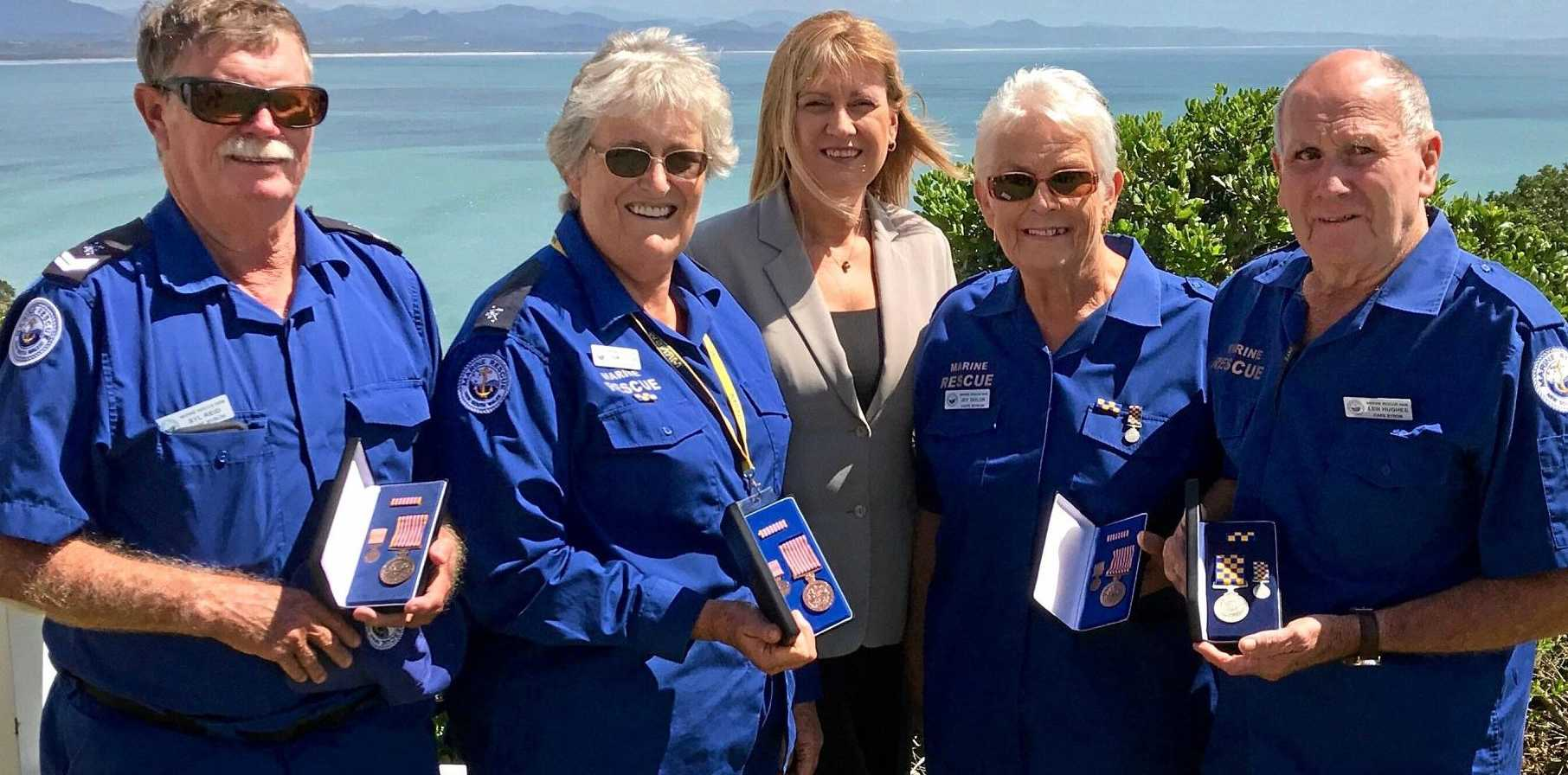 WELL-DESERVED HONOUR: Local marine rescue volunteers Syl Reid, Pam Ditton, Joy Taylor and Len Hughes receive their awards from MP Justine Elliot.