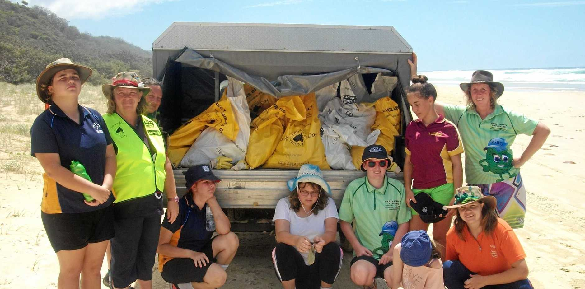 CLEAN SWEEP: Gympie Ranger Guides (back from left) Megan Graham, Sandra Graham, Leonora Cox, Mellissa Willing, Julie Soanes, Breeann O'Donnell, Rhiannon Cox, Annette Anderson, (front Tarra Cluff Karra Graham with their rubbish haul south of Freshwater.