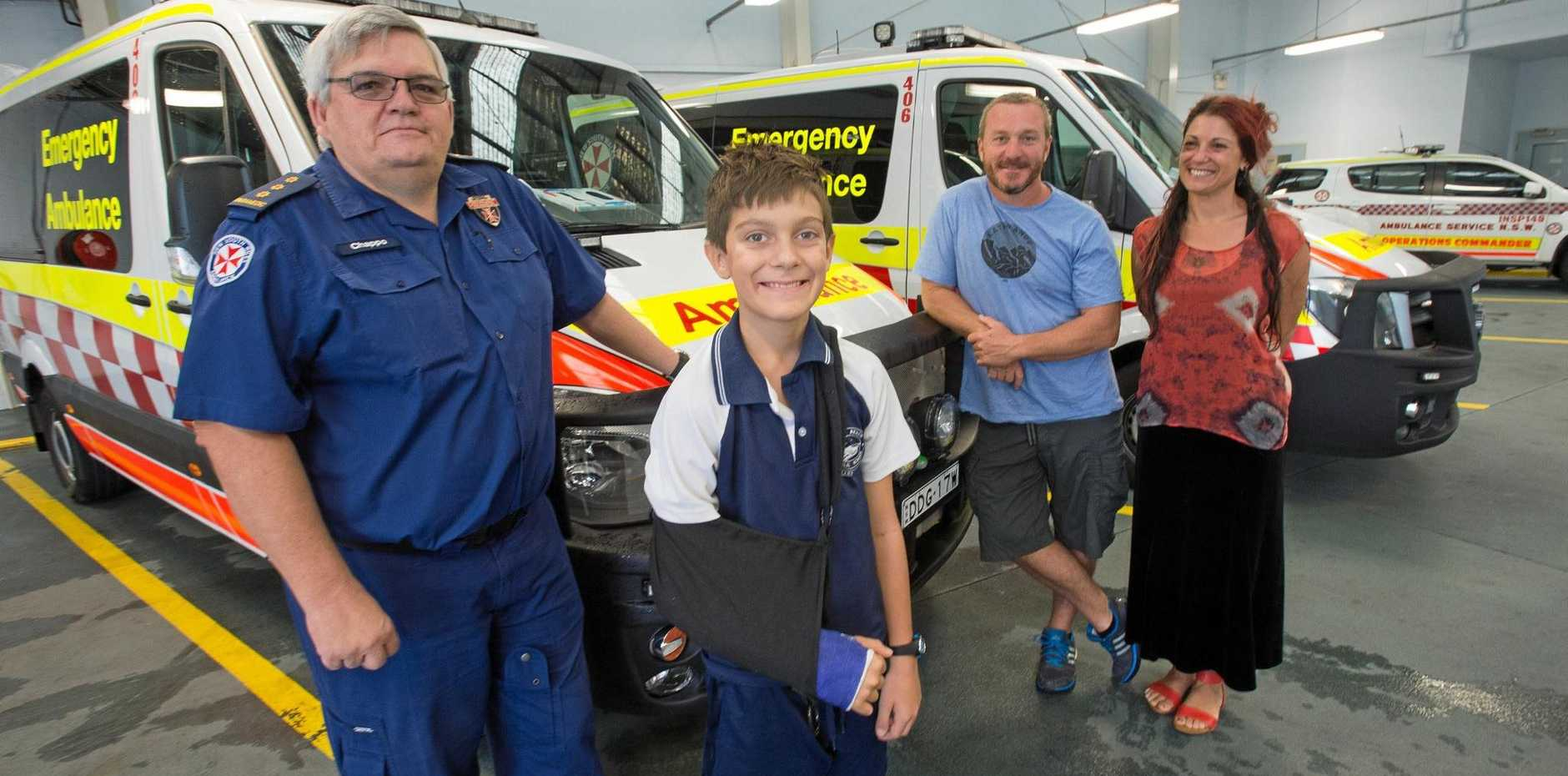 BIG THANKS: NSW Ambulance Coffs Harbour Inspector Andrew Chapman with Ely, 11, his mother Leerah and father Matt Benson.