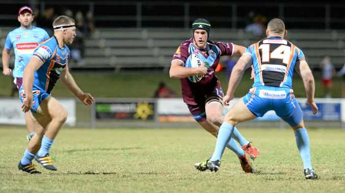 ENFORCER: Calliope product Bill Cullen takes on the Northern Pride during last season's Intrust Super Cup.