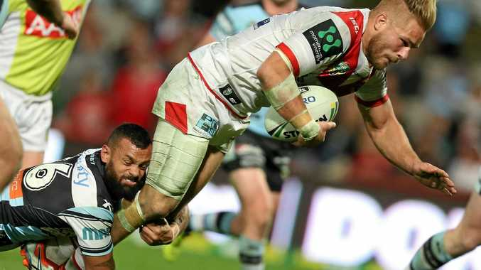 Jack De Belin, pictured being tackled last season by the Sharks' Jayson Bukuya, has extended his contract at the Dragons.